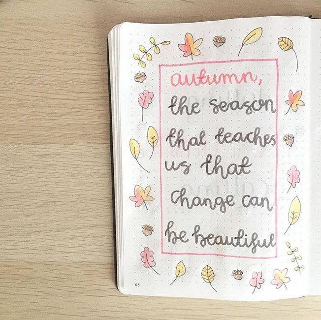 """A bullet journal page with doodles of autumn leaves, and a quote that reads """"autumn, the season that teaches us that change can be beautiful."""""""