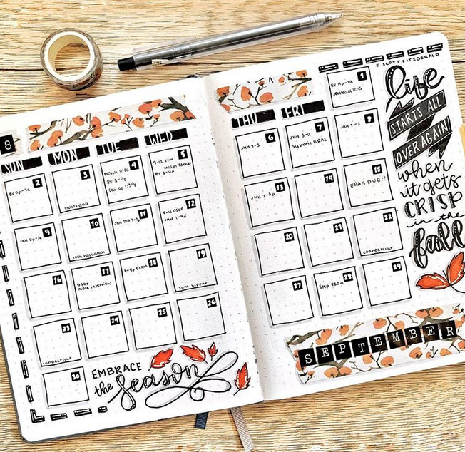 September bullet journal monthly calendar spread autumn leaves and fall quotes with washi tape
