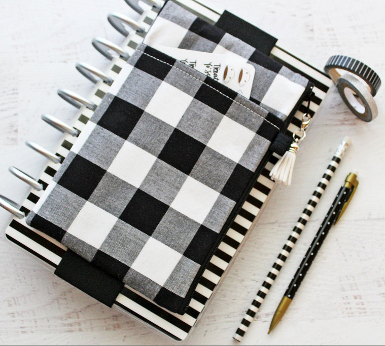A larger zip up case that attaches to a planner notebook that can be used as a purse.