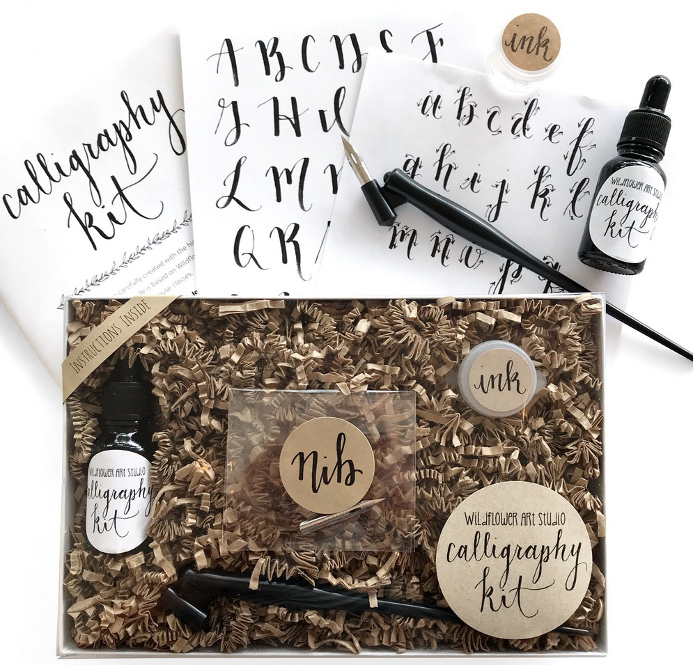 A more traditional calligraphy kit inside a beautifully packaged box. Nibs, ink, a pen and a book.